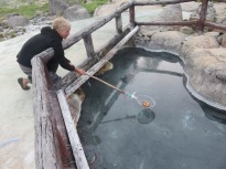 Ginette boiling our eggs in the hot springs