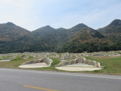 A local grave yard, mounds of built up earth behind each memorial