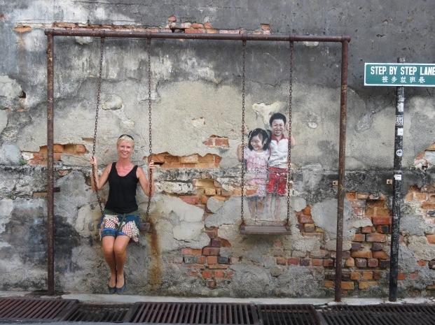 clever street art - Banksy must have visited Penang...