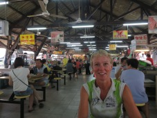 Red faced Ginette eating in one of the many food halls in Malaysia