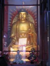 Buddhist inside a temple - Kek LoK Si
