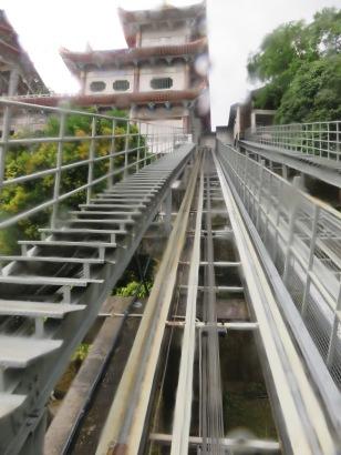 vernacular railway unto a very wet temple in Penang