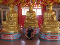 one buddha and three statutes