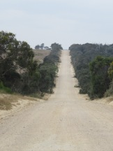 The road on the NE corner, turned into dirt track for 10 miles.