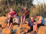A small crowd gathered on the beach for sunset at Greymouth