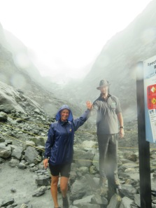 A wet Franz Josef Glacier in the back ground, the man is actually a poster not a pin up.