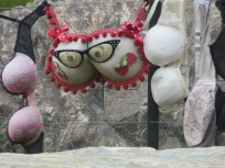 One of many other bras that had been hung on display on a fence by the roadside.