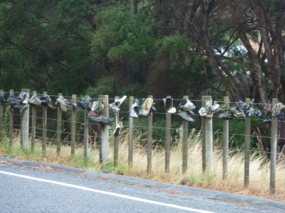 What is with these shoes tied to fences?